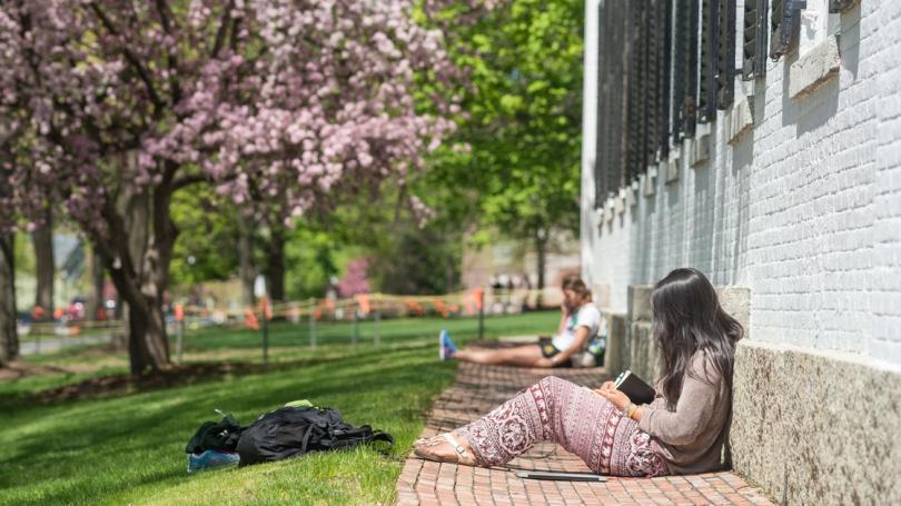 Students studying outside Reed Hall. (Photo by Eli Burakian '00)